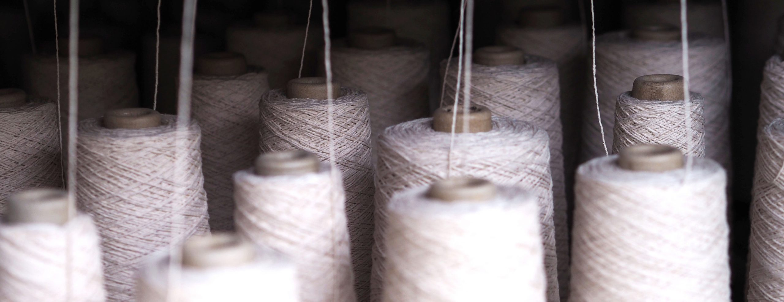 Row of textile threads industry .